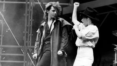 INXS singer Michael Hutchence duets with Jenny Morris at the Countdown Music and Video Awards at the Sydney Enterainment Centre on 11 December 1986.