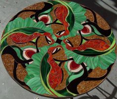 http://studioluminaria.com/wordpress/wp-content/gallery/art-mosaics/mosaic-table.jpg