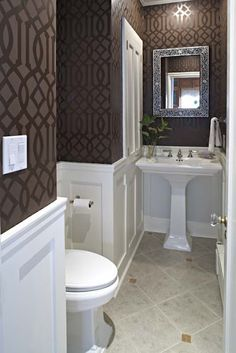 wainscotting and tone on tone stenciled walls in the powder room