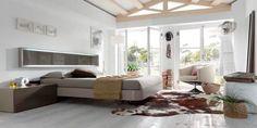 Dormitorio en madera con detalles en blanco