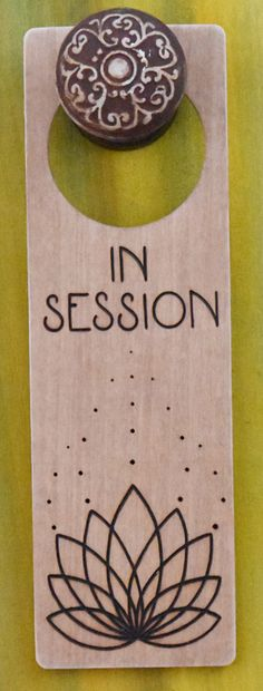 Wood-burned door hanger sign with geometric lotus flower, In Session door sign for therapy or spa. https://www.etsy.com/shop/DesignsByHeidiLynne