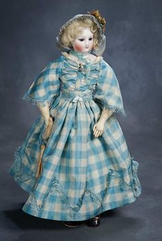 French Bisque Poupee with Cobalt Blue Eyes, circa 1860, Barrois,circa 1860. Wearing a  beautiful aqua/cream silk costume with silk fringe, undergarments,blue silk bonnet,leather shoes,and carved bone fan with hand-painted flowers.