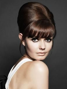 Andrew Collinge, Creative Director, Andrew Collinge Hairdressing, created soft and sexy finishes that evoke a modern interpretation of the silhouettes of the '60s and '70s. The flattering fringes and soft face frames are timeless, looking as modern today as they did decades ago.