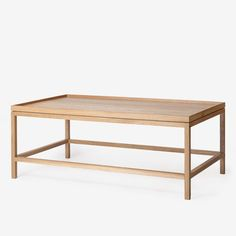 With precise angles and perfect proportions, the Ko Table's generous tray top is lofted on airy legs. Made of American white oak and finished with a beautiful l