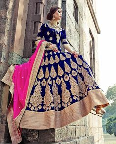 Blue golden embroidered lehenga with pink dupatta 1. Blue velvet embroidered lehenga2. Comes with unstitched blouse material and dupatta