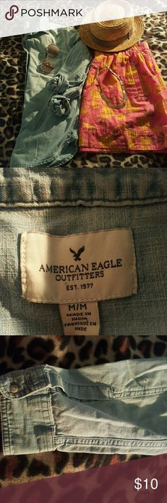 American Eagle chambray top Tiny hole in the back of lower left sleeve, other wise in great condition. Great for skirts, white shorts or as a layering piece. American Eagle Outfitters Tops Button Down Shirts