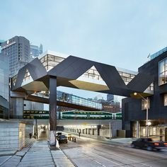This enclosed bridge with a geometric black and white facade connects a hotel to the Metro Toronto Convention Centre
