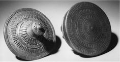 Belt Jewelry: hanging bowls and tutulus, from a victim abandonment by Borbjerg in North Jutland. 1:2.