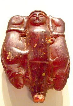 Goddess Holding Animals Italic 500-400 BCE Amber  Etruscan