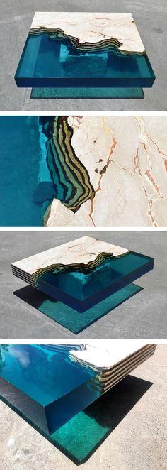 deze salon tafel is een combinatie van hars en steen hierdoor is een soort strand en zee gecreëerd wat een hele aparte look geeft