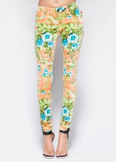"""Floral five pocket low rise denim pants featuring neon orange top-stitching with gunmetal skull rivets. Button and zip fly closure.  98% Polyester, 2% Spandex 40"""" length Model is wearing size 26"""