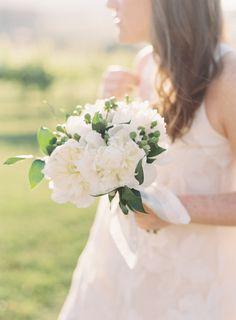Fluffy white peonies: http://www.stylemepretty.com/2016/06/10/timeless-traditional-vineyard-wedding/ | Photography: Clary Pfeiffer - claryphoto.com