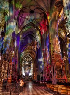 The interior of the Stephannsdom Catherdral in the heart of Vienna lit colorfully by light from the stained glass windows