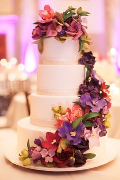 Purple and Fuchsia Floral Garland on Wedding Cake | photography by http://www.christinechangphotoblog.com/