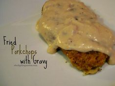FRIED PORK CHOPS WITH GRAVY | This meal reminds me of my grandmother and how she use to cook this all the time when I was a little girl. She use to serve it with mashed potatoes and green beans. I like to serve mine with Easy Cheesy Twice Baked Potato and Green Beans Almondine then Creamy Banana Pudding for dessert. | CLICK FOR RECIPE