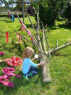 "Decorating a cut tree at Children's Wellness Preschool ("",)"
