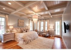 Watercolor beach house bedroom. Love this except for the t.v. hanging on the wall...kind of ruins the entire feel of the room for me.