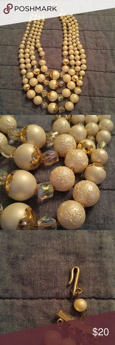 """Vintage 4 Strands Pearls Beads Necklace Japan Vintage 4 Strand Graduated Pearls (White and silver) and beads Necklace. Clasp says Japan. It is 20"""" long. Jewelry Necklaces"""