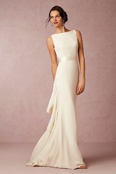 Valentina Gown from BHLDN. We love the classic look in the front and the fashion forward look in the back!