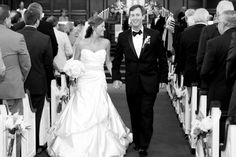 Gayle Booker Photography catching our bride Bronwyn and her adorable husband on their way out of the church.