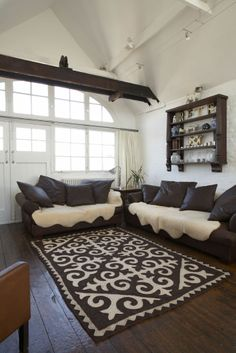 Large neutral Shyrdak rug from Felt in brown and white in a warehouse conversion in South London feltrugs.co.uk