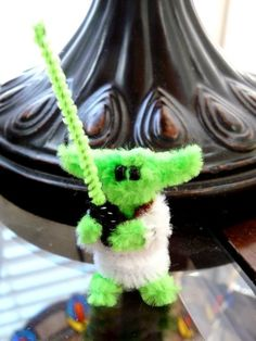 Yes, it really is Yoda!! Complete with his own little fuzzy light saber, Mini Yoda is ready to impart his jedi wisdom on you! He is made of chenille