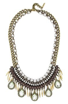 Tiers of twinkling crystals, metallic fringe and oversized mint teardrops sparkle on this outfit-making necklace with boho-chic style.