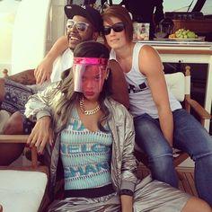 Rihanna in Norway wearing Lanvin pink visor, Lanvin silver metallic bomber jacket and shorts, Chanel swimsuit