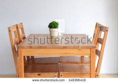 Wooden dining table for 4 people - stock photo