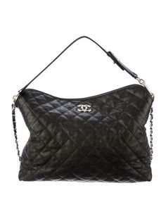 From the Cruise 2012 Collection. Black quilted caviar leather Chanel French Riviera hobo with silver-tone hardware, CC logo plaque at top rear face, chain link shoulder strap featuring woven leather detail, detachable top handle featuring peg in hole and swivel hook closures, burgundy woven lining, three pockets at interior walls; one with zip closure, strap at interior featuring hook closure and flap top meeting magnetic closure. Serial number reads 15508506. Shop Chanel new and pre-owned…