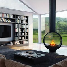 Terrific Totally Free Contemporary Fireplace double sided Ideas Modern fireplace designs can cover a broader category compared with their contemporary counterparts. Suspended Fireplace, Hanging Fireplace, Freestanding Fireplace, Bedroom Fireplace, Home Fireplace, Fireplace Design, Fireplace Ideas, Fireplace Kitchen, Fireplace Outdoor