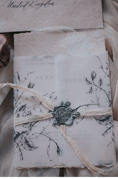 floral vellum wrapped handmade paper calligraphy wedding invitation with wax seal. #weddinginvitation