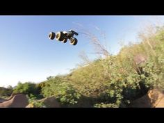 IJumpRC Edition Traxxas E-Revo Dirt Jump Backflips - YouTube