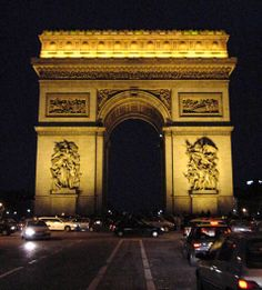 l'Arc de Triomphe; Napolean's triumphal arch, celebrating battle victories.  Stands proudly at the top of the Champs-Elysees and is one of the city's most enduring images.