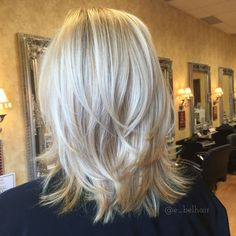 Shoulder length cut with tousled layers and fresh blonde color
