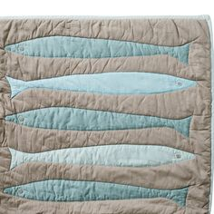 Fisherman's Quilt  This well-weathered quilt is perfect in guest rooms and cozy cabins. Iconic fish shapes are appliqued in contrasting seaglass colors with blanket stitching. Stonewashed 100% cotton percale becomes even softer with every wash.