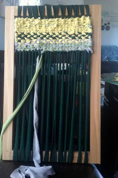 This is a loom that I made from some leftover wood. So i decided to make use of some t-shirts and make a rag rug.
