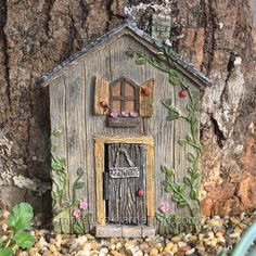 The Ladybug Fairy Door is made of resin, but appears as if it was constructed from weathered wooden panels that have spent many warm afternoons soaking up the summer sun. Gnome Door, Gnome House, Fairy Garden Houses, Gnome Garden, Fairy Gardening, Gardening Tips, Fairy Furniture, Bath And Beyond Coupon, Fairy Doors