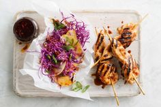 The tangy Asian chicken skewers form the perfect contrast to the sweet, fragrant nashi slaw.