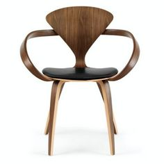 Organic with a twist, Norman Cherner's Cherner Armchair with Seat Pad has a curvaceous and contemporary silhouette. http://www.yliving.com/blog/the-icons-modern-side-chairs/