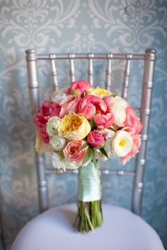"Bright, Cheerful & Exuberant:  ""This pink, yellow and white bridal bouquet seems to be bursting feminine delight at marrying the perfect man (or woman)."" ~ Sarah of Luck Photography    ****  Photo by Heather Cook Elliott. Florals by Marius Bell."