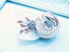 Pure silk rosette and rhinestones occasion hair piece on etsy.