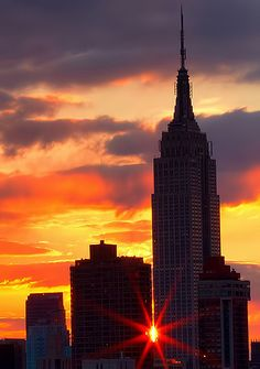 Sunset starburst squeezes by the Empire State Building