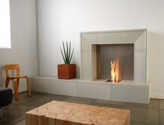 Contemporary Fireplace Design Ideas for Classic Fireplace Theme: Simple Grey Fireplace Plant Pot Wooden Ornamented Table Contemporary Fireplace Design Ideas ~ dickoatts.com Fireplace Inspiration