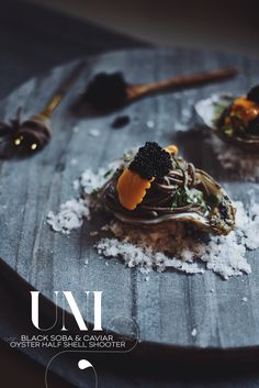 Uni Oyster Shooter On The Half Shell With Black Soba and Caviar