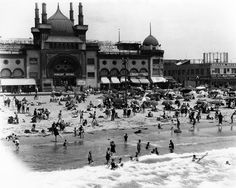 Swimmers frolic in the surf at the Ocean Park Bath House, Los Angeles, 1922.