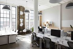 Muuto Under the Bell lamp and mini Stacked shelves at Scandinavian-Inspired Office Design in NYC