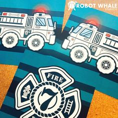 3 prints of firetrucks and a firefighter badge getting ready to head out to their new owner. For a firefighter kids bedroom.