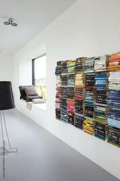 I love the way that these floating book shelves make these stacks works of art. Ordered up a few for the living room!