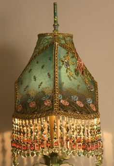 Victorian Lampshade on Floral Tole Base. Looks like something from an old hotel lobby. Looks awesome!
